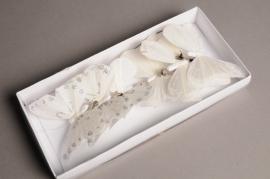 A001J9Box of 6 white glitter butterflies 9cm