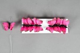 A015E9 Boîte de 12 pics papillons fuchsia D6cm H23cm