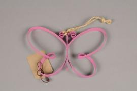A010AK Papillon en métal fuchsia H11cm