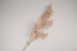 xx42ee Branche de fougère artificielle enneigée rose H110cm